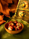 Chestnuts in a bowl Stock Images