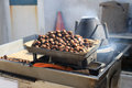 Chestnuts roasting on the streets of portugal europe Royalty Free Stock Photography