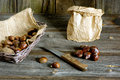 Chestnuts sweet in basket paper bag and knife Stock Image