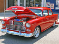 Chevrolet this is a bright red with a powerful v engine custom paint and after market wheels Stock Images