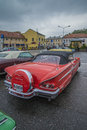 Chevrolet impala convertible image is shot a rainy afternoon in july at the fish market in halden norway Stock Image