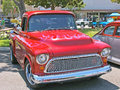 Chevrolet truck this is a nicely restored mid s red with a chrome grill after market wheels and custom red paint job with flame Stock Image