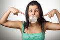 Chewing gum girl pretty young with crossed eyes blowing a big bubble Stock Photography