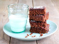 Chewy chocolate and coconut slice milk in glass Royalty Free Stock Images