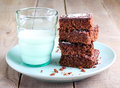 Chewy chocolate and coconut slice milk in glass Stock Images