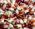 Chewy cola bottle background a popular retro sweet also known as gummy candy at a pick and mix self service market Royalty Free Stock Image