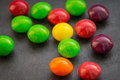 Chewy dragees colorful on a dark background Royalty Free Stock Photography