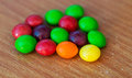 Chewy dragees colorful on a wood table Stock Photo