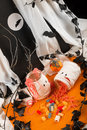 Chewy halloween sweets coming out of a jar decorated as a mummy Stock Images