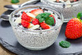 Chia seed pudding with strawberries, almond and chocolate cookie crumbs Royalty Free Stock Photo