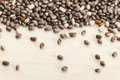 Chia seeds on poplar wood surface a close up with a shallow depth of field Stock Photography