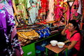 Chiang Mai, Thailand: Woman Selling Silks Royalty Free Stock Photos