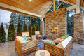 Chic covered back patio with built in gas fireplace Royalty Free Stock Photo