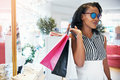 Chic elegant young African woman out shopping Royalty Free Stock Photo