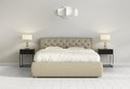 Chic tufted leather bed in contemporary chic bedroom front Royalty Free Stock Photo