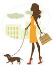 Chic woman walking with dachshund illustration of Stock Photo