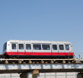 Chicago airport shuttle on tracks red and silver o hare train under blue skies Royalty Free Stock Image