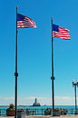 Chicago: american flags and the Chicago Harbor Lighthouse seen from Navy Pier on September 22, 2014 Royalty Free Stock Photo