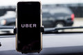 Chicago,IL,USA,Feb-21,2017,Smartphone attached to a car mount in car with Uber logo for editorial use only Royalty Free Stock Photo