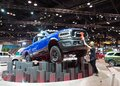 Male person dusting an elevated blue RAM pickup truck displayed at the Chicago Auto Show Royalty Free Stock Photo