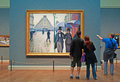 Chicago: looking at oil painting Paris Street Rainy Day by Gustave Caillebotte at Art Institute of Chicago on September 23, 2014 Royalty Free Stock Photo