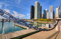 Chicago marina a wide angle view of downtown from lake michigan framed by nautical chain railing Royalty Free Stock Photo