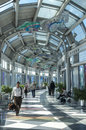 Chicago o hare airport usa april travelers make their way through a beautifully constructed hall surrounded by windows at s Royalty Free Stock Image