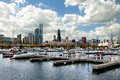 Chicago skyline view from burnham harbor with docked boats Stock Photography