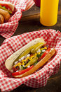 Chicago style hot dog with mustard pickle tomato relish and onion Stock Photo
