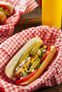 Chicago style hot dog with mustard pickle tomato relish and onion Stock Images