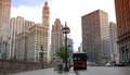 Chicago tourist bus red and building in background Royalty Free Stock Image