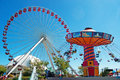 Chicago: wave swinger and Ferris Wheel at Navy Pier on September 22, 2014 Royalty Free Stock Photo