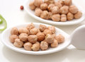 Chick peas some dried on a spoon Royalty Free Stock Images