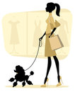 Chick woman shopping with her poodle Stock Photos