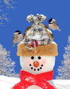 Chickadees on a festive snowman Royalty Free Stock Photo