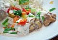 Chicken ala king style diced in a cream sauce and often with mushrooms and vegetables served over rice Stock Photo