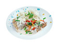 Chicken ala king style diced in a cream sauce and often with mushrooms and vegetables served over rice Stock Image