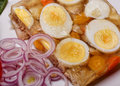 Chicken aspic and red onions boiled eggs vegetable salad in with slices Stock Photos