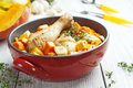 Chicken baked with pumpkin in the red ceramic form Stock Image