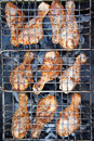 Chicken on the Barbecue in a lattice Stock Photography