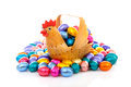 Chicken basket colorful chocolate easter eggs over white background Stock Photos