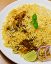 Chicken biryani biriani or beriani is a set of rice based foods made with spices rice usually basmati and meat fish eggs or Stock Images