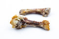 Chicken bones isolated over white background Stock Images