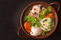 Chicken bouillon with vegetables and spices in a ceramic pot Stock Photo