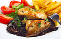 Chicken breast on a bed of fried mushrooms Stock Photo