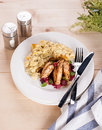 Chicken breast grilled scramble eggs berry sauce on wooden table country style Royalty Free Stock Images