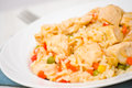 Chicken breast with rice and vegetables on plate Stock Photo