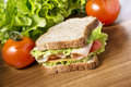 Chicken breast sandwich with salad cheese and tomatoes Royalty Free Stock Photos