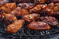 Chicken buffalo wings cooked on smoke grill Royalty Free Stock Photo