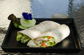 Chicken caesar wrap on a black plate Stock Image